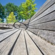 Wide Angle View Curving Row of Benches - Stock Photo