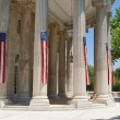 Royalty-Free Stock Photo: Narrow American Flags Columns Building Washington