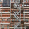 Scaffolding Old Brick Building Under Renovation - Stockfoto