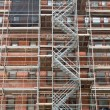 Stock Photo: Scaffolding Old Brick Building Under Renovation