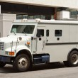 Armoured Armored Car Parked on Street Building - Foto Stock