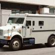Armoured Armored Car Parked on Street Building - Stock Photo