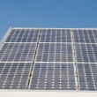 Row of Solar Panels on Roof Against Blue Sky — Stock Photo