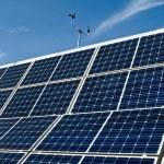 PV Solar Panel Array Against Blue Sky Anemometer — Stock Photo