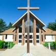 Modern Church A Frame Gabled Roof Metal Cross - Stock Photo