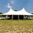 Large White Event Tent, Grass, Blue Sky - Stock Photo
