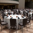 Large Room Set Up for a Banquet, Round Tables - Stock Photo