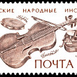 Stock Photo: belorussian folk music instruments postage stamp