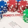 Stock Photo: Bet House Poker Chips on Foreclosed Mortgage