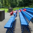 XXXL Rows of Blue Red Metal Folding Chairs Outside — Stock Photo #7896664