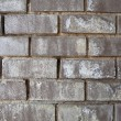 XXXL Weathered Black Brick Wall with White Mineral Deposits - Stock Photo