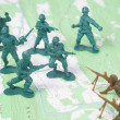 Stock Photo: Plastic Army Men Fighting on Topographic Map