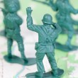 Stock Photo: Plastic Army Men Fighting Topographic Map Leader