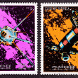 Canceled North Korean Postage Stamp Space Themed Satellites Milk - Stock Photo