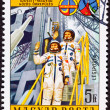 Постер, плакат: Stamp Waving Astronauts Launch Tower Space Suit