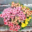 Stock Photo: Bouquet of Flowers Tulips in a Old Metal Flourist Display