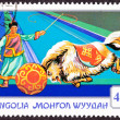 Canceled Mongolian Postage Stamp Performing Yak Pushing Ball, Ci - Stock Photo