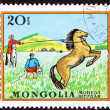 Canceled Mongolian Postage Stamp Men Capturing Lassoing Wild Hor — Stock Photo