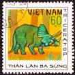 Canceled Vietnamese Postage Stamp Green Triceratops Dinosaur in — Stock Photo