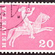 Foto de Stock  : Swiss Postage Stamp Horseback Mail Delivery, Rider Blowing Posta