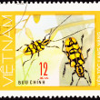 Stock Photo: Canceled Vietnam Postage Stamp Pair Yellow Beetles AntennOn Pl