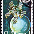 Foto de Stock  : Canceled Cuban Postage Stamp Intercosmos Satellite Orbiting Plan