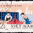Canceled North Vietnamese Postage Stamp Children Playing Buildin - Stock Photo