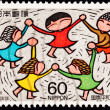 Royalty-Free Stock Photo: Canceled Japanese Postage Stamp Multicultural Children Holding H