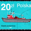 Royalty-Free Stock Photo: Canceled Polish  Postage Stamp Side View Red Fire boat Tug Polan