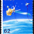 Royalty-Free Stock Photo: Canceled Japanese Postage Stamp Satellite Solar Panel Spacecraft