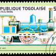 Stock Photo: Canceled Togo Postage Stamp Old ItaliRailroad Steam Engine Lo