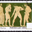Royalty-Free Stock Photo: Laos Postage Stamp Side View Nude Greek Athletes Laurel Wreath