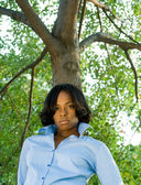 Pouting African American Woman Leaning Tree — Stock Photo