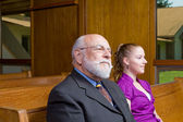 Senior Caucasian Man and Young Woman Sitting in Church Pew — Stock Photo