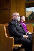 Older White Man Younger Woman Sitting Church Pew — Stock Photo