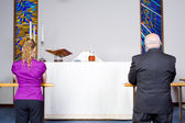 Two Caucasian Kneeling Taking Communion at Church Alter — Stock Photo