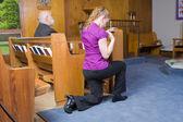 Caucasian Woman Kneeling Crossing Herself Church — Stock Photo