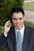 Asian Businessman Holding Cell Phone Outside Park — Stock Photo