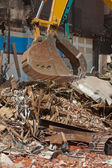 Demolition Equipment Claw, Pile of Debris at Work Site — Stock Photo