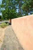 Adobe Wall to a Vanishing Point Sidewalk Santa Fe — Stock Photo