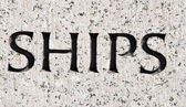 """Word """"Ships"""" Carved in Gray Granite Stone Boats — Stockfoto"""