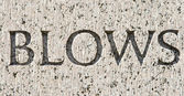 "Word ""Blows"" Carved in Gray Granite Stone — Stock Photo"