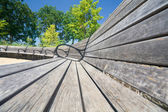 Wide Angle View Curving Row of Benches — Stock Photo