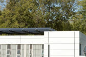 Modern Solar Home with Row PV Panels on Roof — Stock Photo