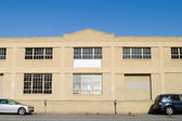 Exterior of Old Warehouse, Street, Parked Cars, Blue Sky — Stock Photo
