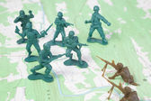 Plastic Army Men Fighting on Topographic Map — Stock Photo