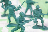 Plastic Army Men Fighting on Topographic Map Squad Attacks — Stock Photo