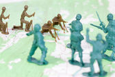 Plastic Army Men Fighting on Topographic Map Opposing Sides War — Stock Photo