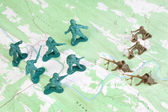 Plastic Army Men Fighting on Topographic Map General's View — Stock Photo