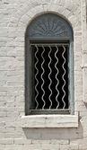 Window with Decorative Bars and Sunrise — Stock Photo